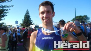 Anglesea's Julian Spence, 28, says he was thrilled to win the Great Ocean Road Marathon after he finished runner-up last year. Spence finished yesterday's run with a time of 2.37.23.