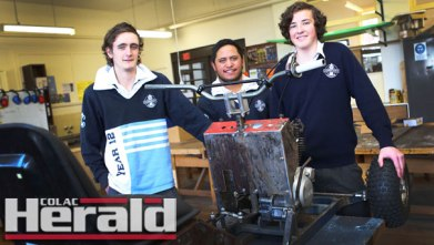 Camperdown College students, from left, Brad Hinkley, Tyrone Emery and Nick Frith have been a part of a VCAL class which is building a racing lawnmower.