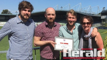Colac Herald sports editor Ben Martin, former reporter Lachlan Cowlishaw, current sports reporter Alex Baird and photographer Tammy Brown with the Herald's AFL Victoria award.