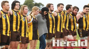 Bryan Noseda's wife of more than two decades Amber, middle, and his two eldest children, Joey, left of her, and Matt stand for a minute's silence in honour of the club legend after the reserves' emotional victory over Colac Imperials.