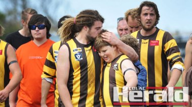 Bryan Noseda's son Matt, left, starred in Apollo Bay reserves' football win three days after his dad's death, and while Bryan's youngest son Isaac, right, kicked a goal in the under-14.5 game.
