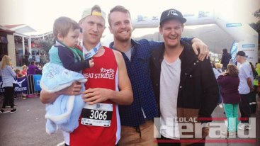 INSPIRATION: Nephew Lakyn, who has cystic fibrosis, greeted his uncle Kaden Newton at the finish line after he completed a 60-kilometre ultra marathon, to raise money for research for the chronic illness. Newton, who raised more than $5500, is also pictured with proud mates Kane Leersen and Sam Parker following the Great Ocean Road Marathon event on Sunday.