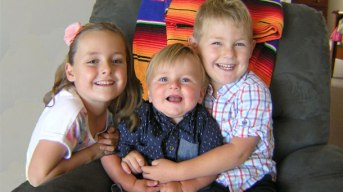 Sienna Leeson, 7, is receiving support from her brothers, Flynn, 19 months, and Isaac, 5.