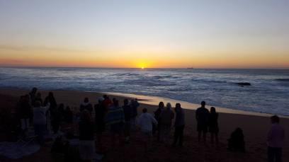 Sunrise prayer gathering for Anne at Umdloti beach. Photo by Alan Haarhoff.
