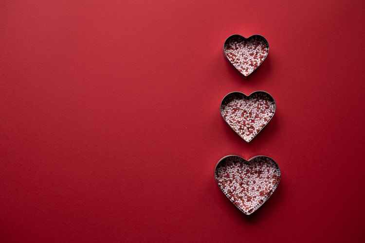 hearts filled with sprinkling for valentine day on surface