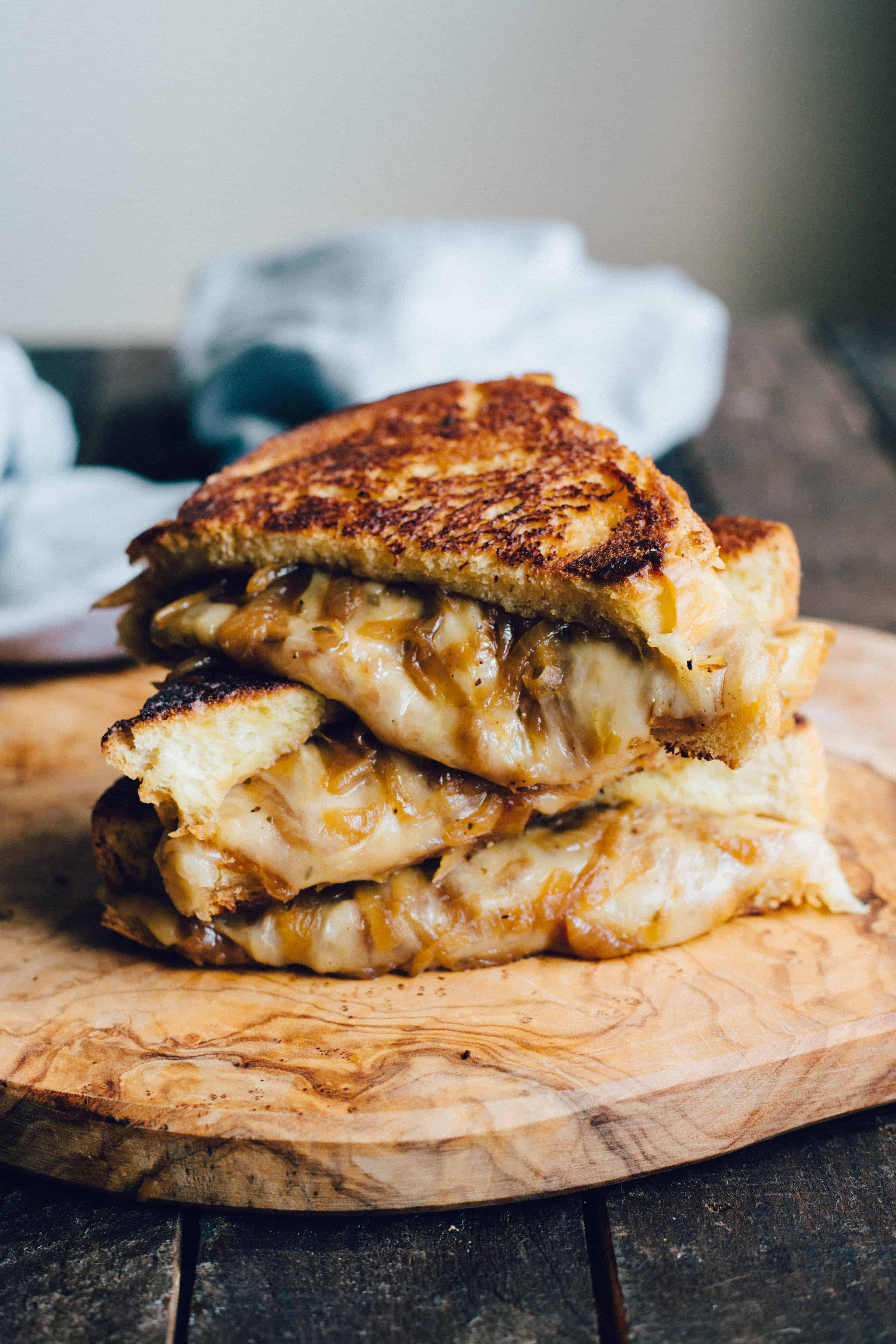 French Onion Grilled Cheese (Video!) - Overflowing with caramelized onions and melty, cheesy goodness!   Coley Cooks