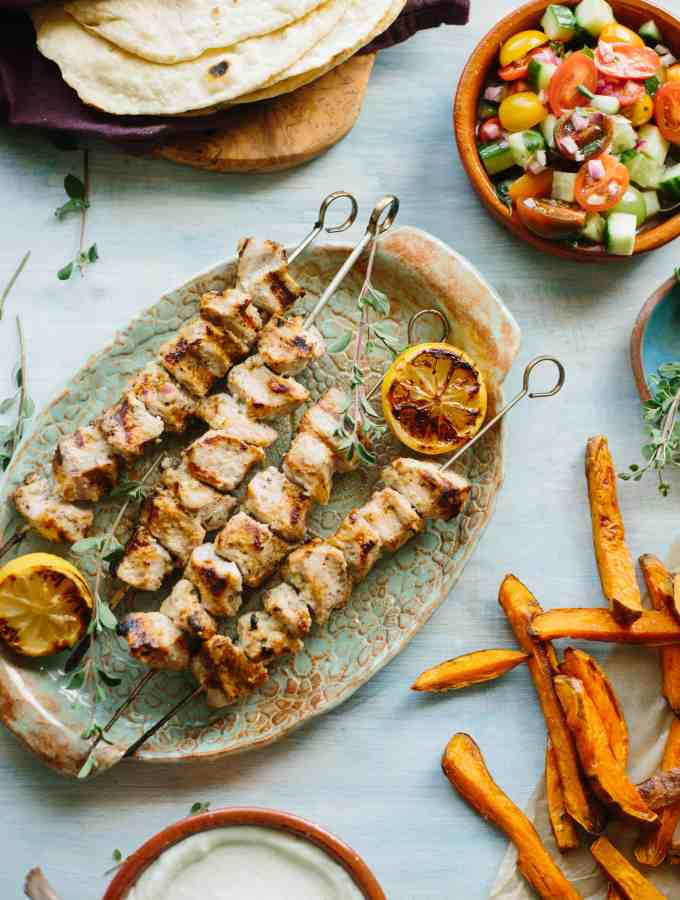 PORK KEBAB PITAS WITH TOUM | Tender Pitas Stuffed with Marinated Pork, Sweet Potato Fries, Tomato Cucumber Salad and a Garlicky Lebanese Sauce called Toum. | ColeyCooks.com