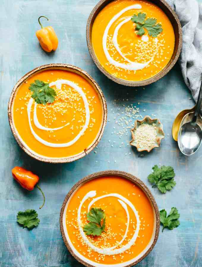 20 Minute Spicy Carrot Soup with Yogurt + Sesame! It's gluten free, vegan friendly, mildly spiced, smooth, creamy and totally delicious! A warming winter soup perfect for snow days! #spicy #easy #carrot #soup #habanero #recipe #yogurt #sesame #glutenfree #vegan #plantbased | ColeyCooks.com