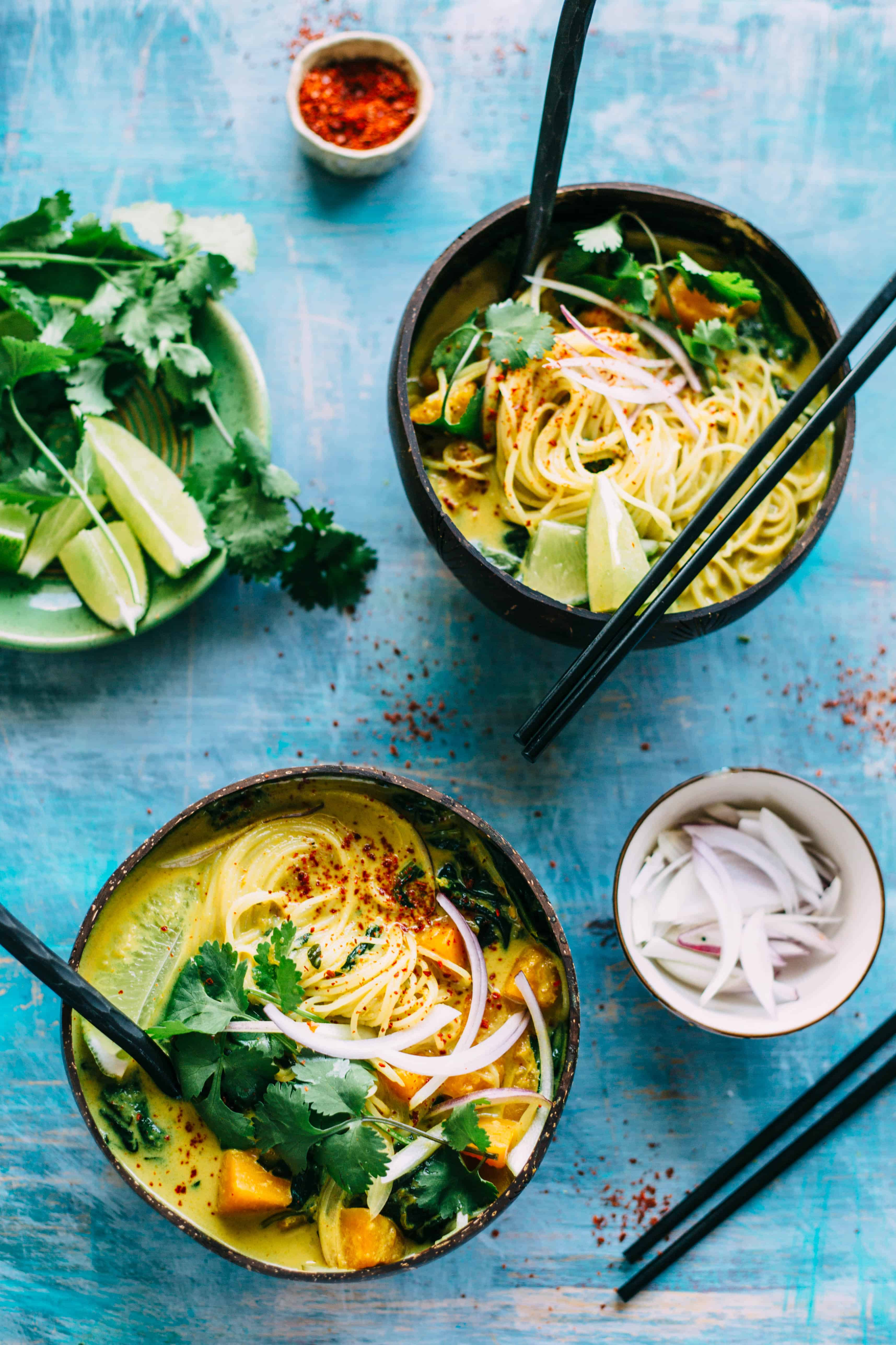 This Butternut Squash + Spinach Coconut Curry Noodle Soup is an easy, warm and flavorful soup recipe that's naturally vegan and gluten free! #vegan #gf #glutenfree #rice #noodles #easy #soup #recipe #coconut #curry #spinach | ColeyCooks.com