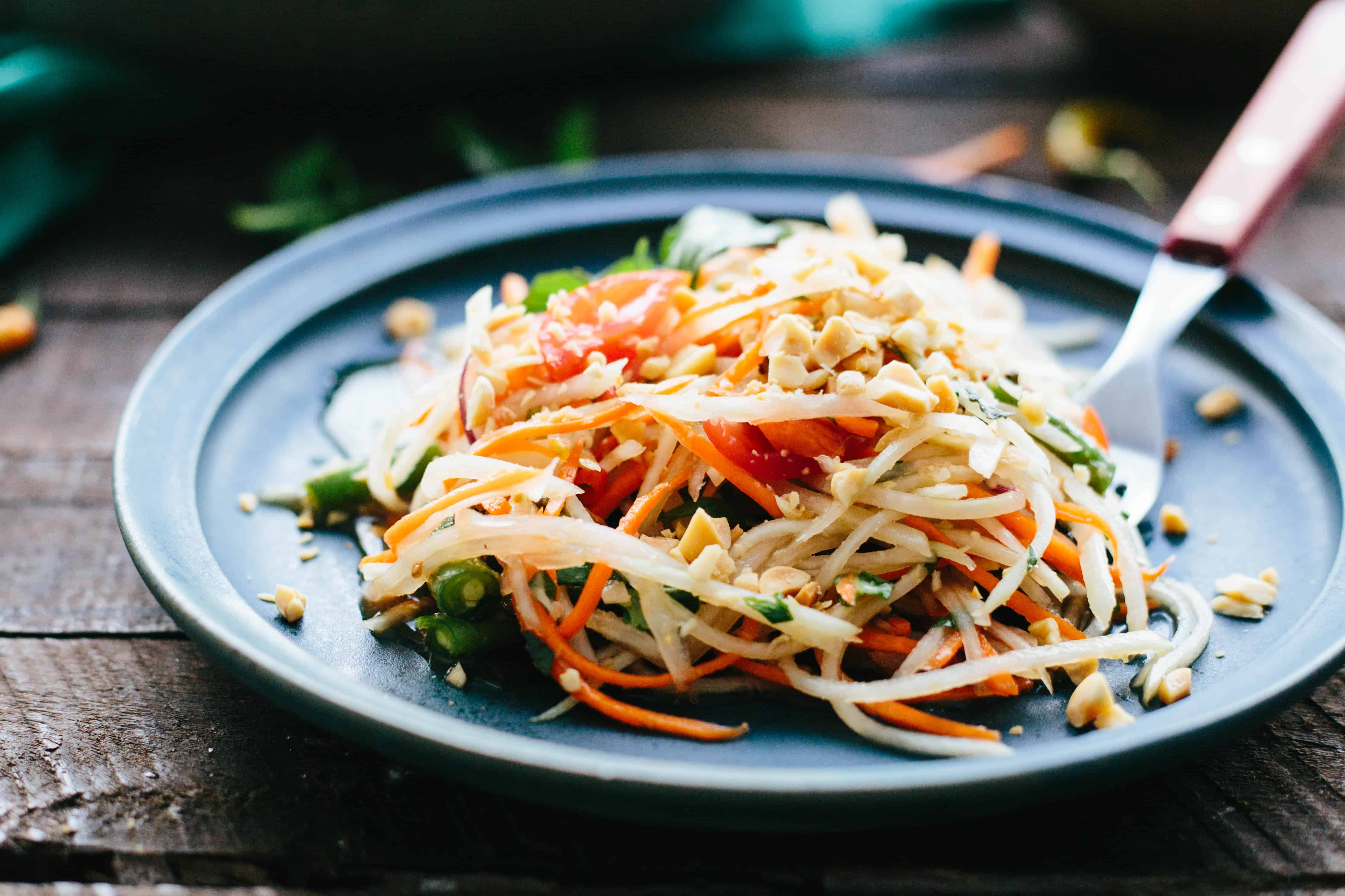 This Thai Green Papaya Salad or Som Tam is a simple healthy and authentic recipe that's packed with flavor. #easy #recipe #healthy #thai #papaya #salad | ColeyCooks.