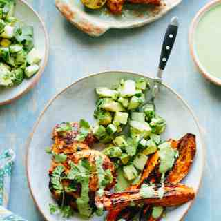 This recipe for Peruvian Grilled Chicken with Spicy Green Sauce, Sweet Potato Wedges + Avocado Cucumber Salad is a healthy, flavorful summer dinner.Paleo, gluten free, dairy free and nut free. #easy #grilled #chicken #recipe #healthy   ColeyCooks.com