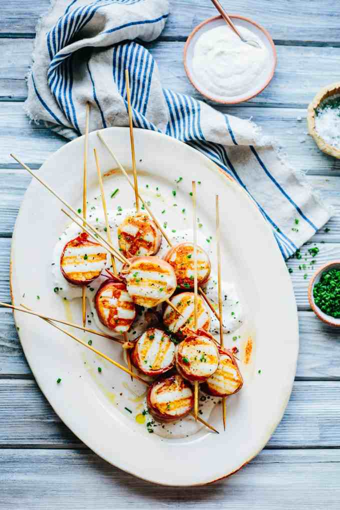 Grilled Scallops Wrapped in Bayonne Ham with Horseradish Cream is the perfect appetizer for summer! Only requires 5 main ingredients. #sponsored #scallops #seafood #grilled #easy #recipe #healthy #MadeInTheEU | ColeyCooks.com