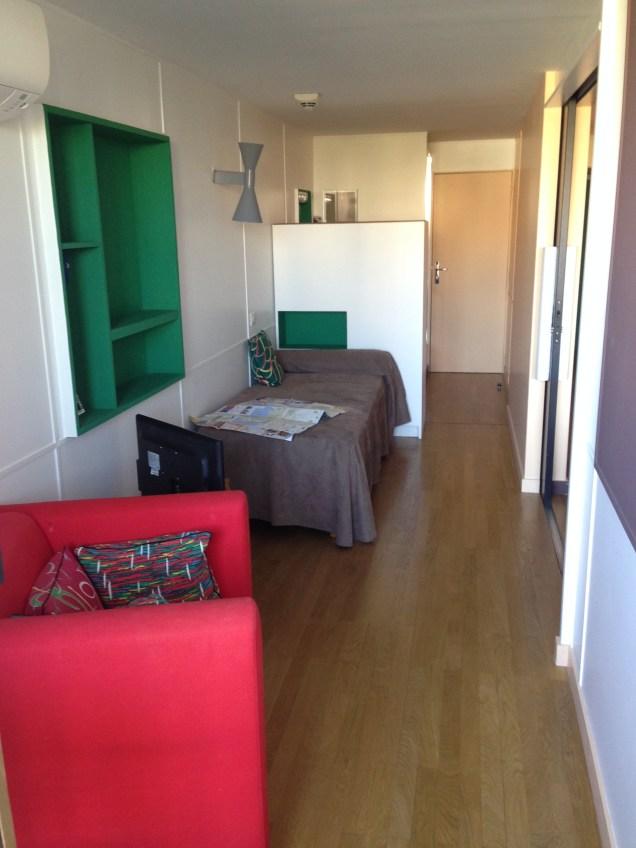 a long, narrow bedroom