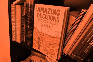 Amazing Decisions by Dan Ariely on a book shelf