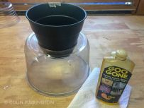 Glue funnel onto dome. Use Goo Gone to remove labels.