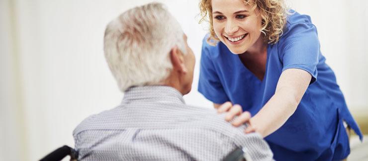 a nurse listening to an elderly patient