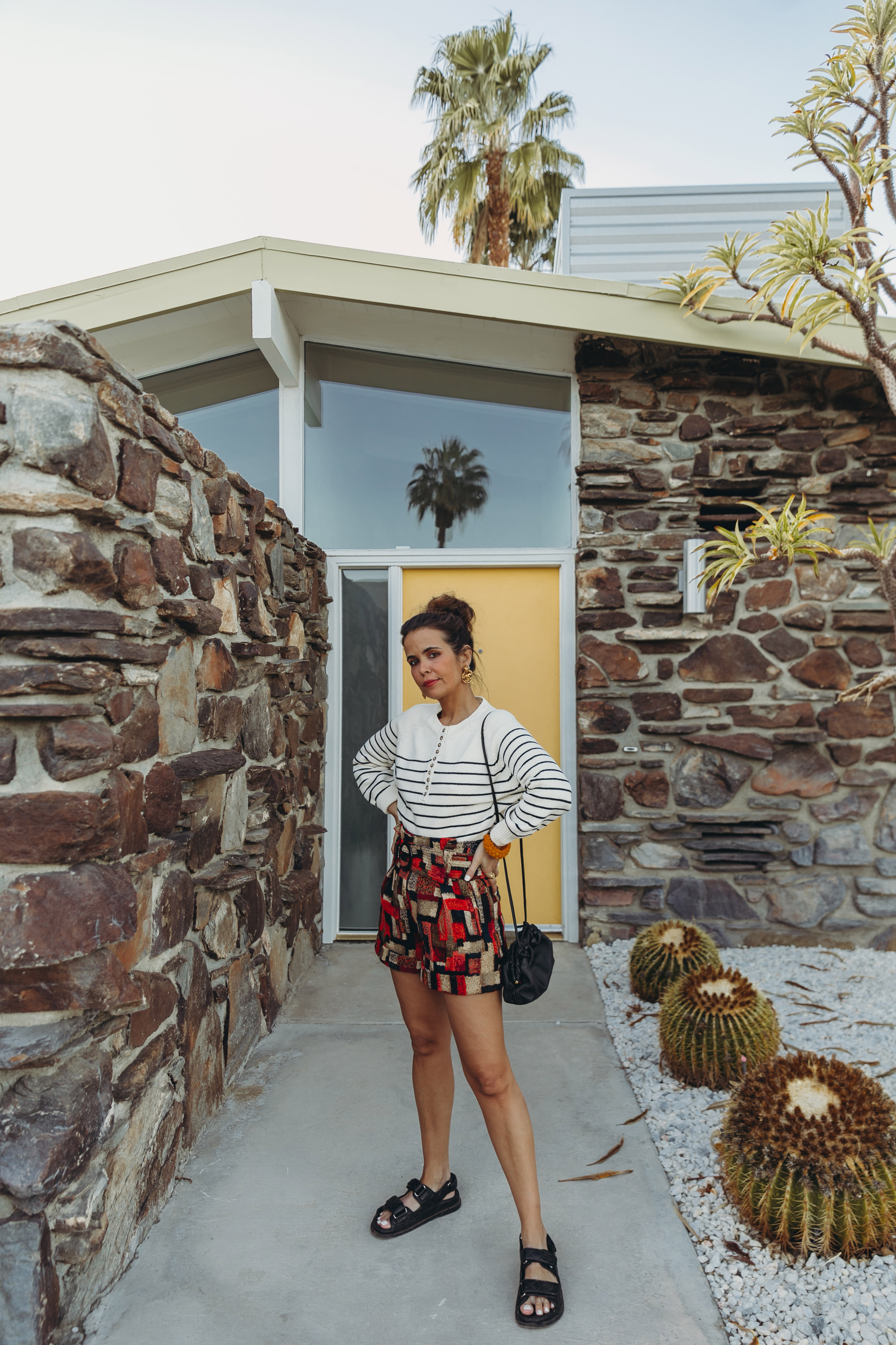 Sara from Collage Vintage wearing Sézane jacquard multicolor shorts and striped jumper and Chanel dad leather sandals