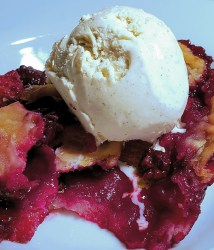 An Organic Mixed Berry Cobbler of blackberries, blueberries and strawberries topped with vanilla ice cream is a dream.