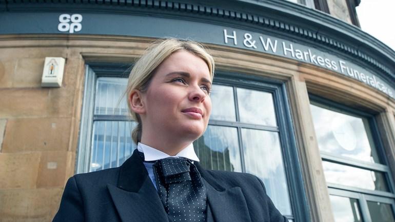 Raegan in her Funeral Director uniform