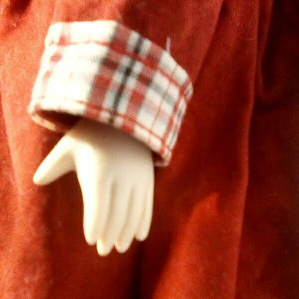 Brunette Doll On Stand hand close up