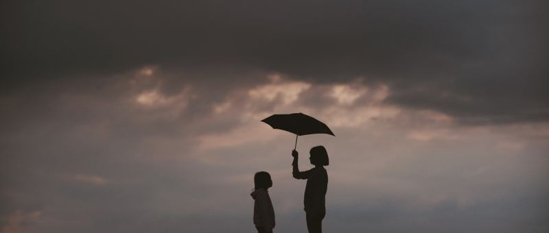 two people under an umbrella - human connection