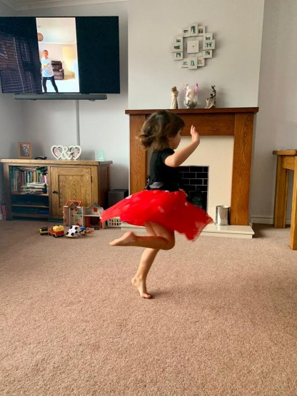 Toddler dancing with tv