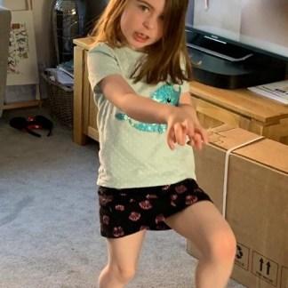 Preschooler posing like a dinosaur