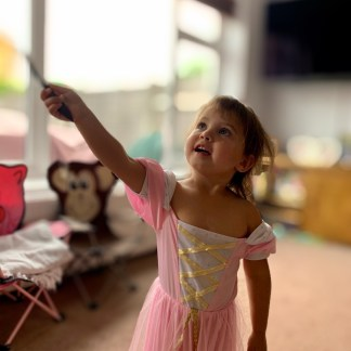 Pre-schooler using her imagination to paint circles in the air