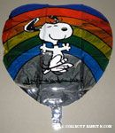 Snoopy dancing in front of rainbow heart-shaped Mylar Balloon