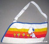 Snoopy bandaging Woodstocks arm sling
