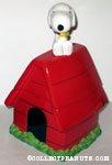 Snoopy hugging Woodstock on Doghouse Cookie Jar