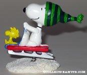 Snoopy & Woodstock on sled spring figurine