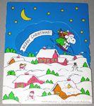 Santa Snoopy flying over village Gift Trim