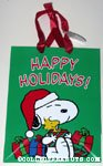 Snoopy holding gift boxes and Woodstock Gift Bag