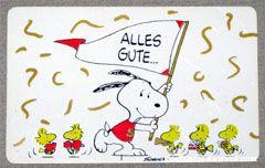 Snoopy waving banner with cheerleader and band Woodstocks 'Alles gute... und herzlichen gluckwunsch!' Wallet Greeting Card