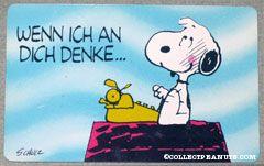 Snoopy sitting on doghouse typing 'Wenn ich an dich denke... geht's mir rundherum gut!' Wallet Greeting Card