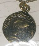 Snoopy with outstretched hand on crest surrounded by wreath bronze-tone Necklace