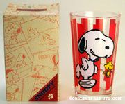 Snoopy and Woodstock dancing on red stripe background Glass