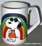 Joe Cool standing with rainbow mug