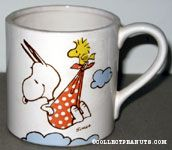 Woodstock stork carrying baby Snoopy in a cloth mug