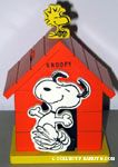 Snoopy dancing next to doghouse with Woodstock Musicbox & Bank