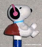 Snoopy leaning on rock wearing headphones Pencil Topper & Eraser