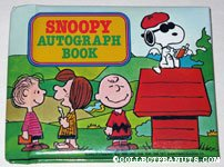 Snoopy signing autographs on doghouse Autograph Book