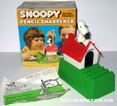 Snoopy writing on typewriter on doghouse pencil sharpener