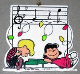 Lucy & Schroeder at piano with notes and Christmas lights Wooden Ornament