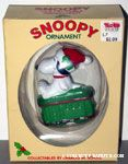 Snoopy wearing santa hat sitting on green train car Ornament