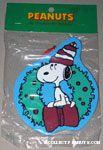 Snoopy sitting in wreath wearing hat Wooden Ornament