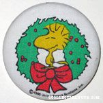 Woodstock standing in Christmas wreath Fabric-covered Button