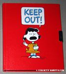Lucy holding book and raising fist 'Keep Out' Diary