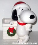 Santa Snoopy leaning on chimney with wreath Planter